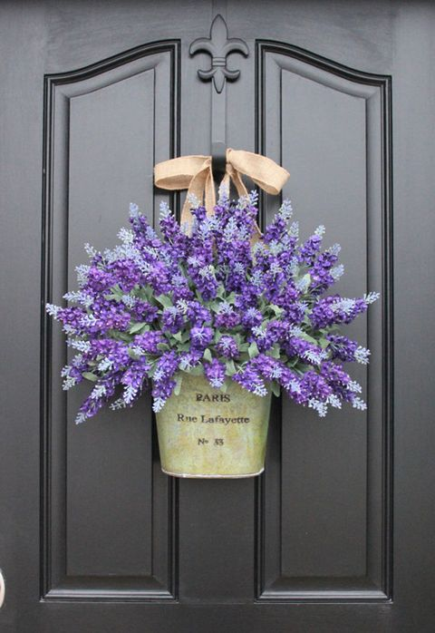 "Is there anything prettier than a big bouquet of <a target=""_blank"" href=""http://www.countryliving.com/gardening/garden-ideas/g1864/lavender-crafts-and-recipes/"">lavender</a>? Visitors and passerby will be instantly taken with your home as they walk by this beautiful display. (This one features faux lavender, but if you're making your own, you can sub in dried lavender, too.)  <em>See more at <a target=""_blank"" href=""https://www.etsy.com/listing/97490151/lavender-wreaths-lavender-fields-spring?utm_source=OpenGraph&amp;utm_medium=PageTools&amp;utm_campaign=Share"">Two Inspire You</a>.</em>"