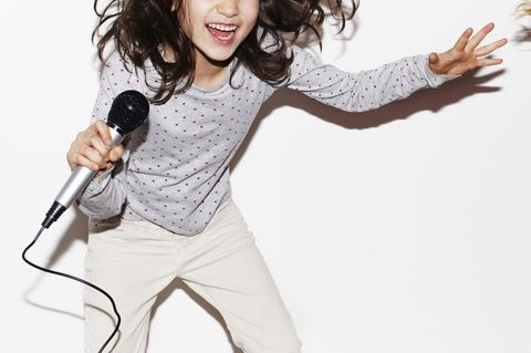 Microphone, Sleeve, Audio equipment, Red, Happy, Facial expression, Audio accessory, Coquelicot, Laugh, Celebrating,