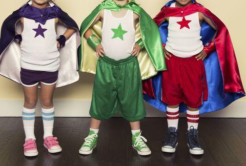 Standing, Fictional character, Superhero, Costume design, Costume, Hero, Justice league, Superman, Costume accessory, Sock,