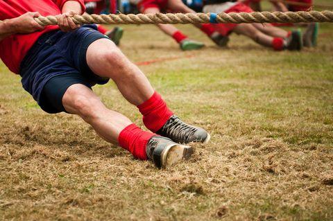 Human leg, Sock, Shoe, Red, Elbow, Shorts, Wrist, Playing sports, Carmine, Knee,