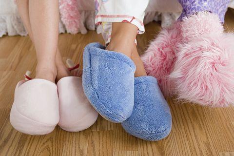 Textile, Pink, Plush, Wood flooring, Slipper, Wool, Foot, Sock, Ankle, Toe,