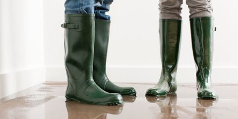 rain boots in flooded home