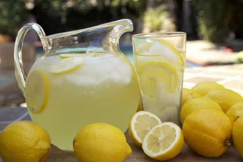pitcher and glass of lemonade outside