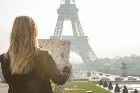 woman looking at map in paris