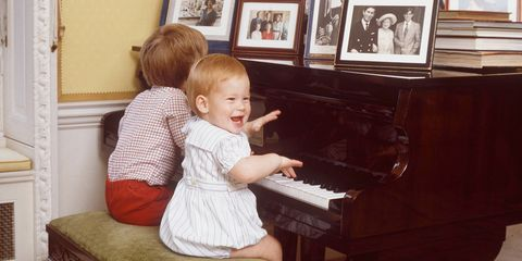 Human, Musical instrument, Keyboard, Musician, Picture frame, Pianist, Child, Organ, Musical instrument accessory, Piano,