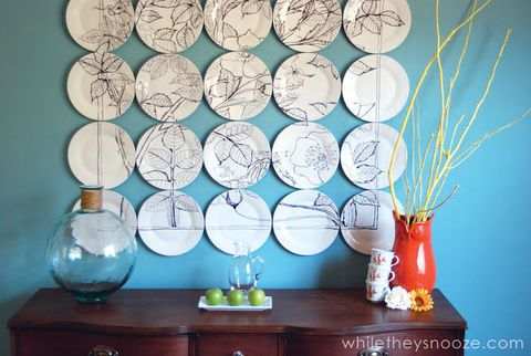 "Inspired by a pricey display at Anthropologie, this clever crafter took some artistic license with a bunch of plain white plates — and the result is striking.  <a target=""_blank"" href=""http://whiletheysnooze.blogspot.com/2013/04/anthropologie-plate-art-knockoff.html""><em>Get the tutorial at While They Snooze »</em></a>"