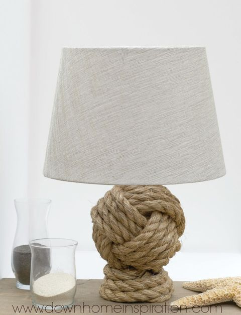 """A monkey's knot lamp base is a cute way to make a nautical statement.   <em>Get the tutorial at <a target=""""_blank"""" href=""""http://www.downhomeinspiration.com/pottery-barn-rope-knot-lamp/"""">Down Home Inspiration</a>.</em>"""