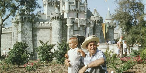 Walt Disney with his grandson at the castle in Disneyland