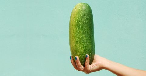 woman holding huge cucumber