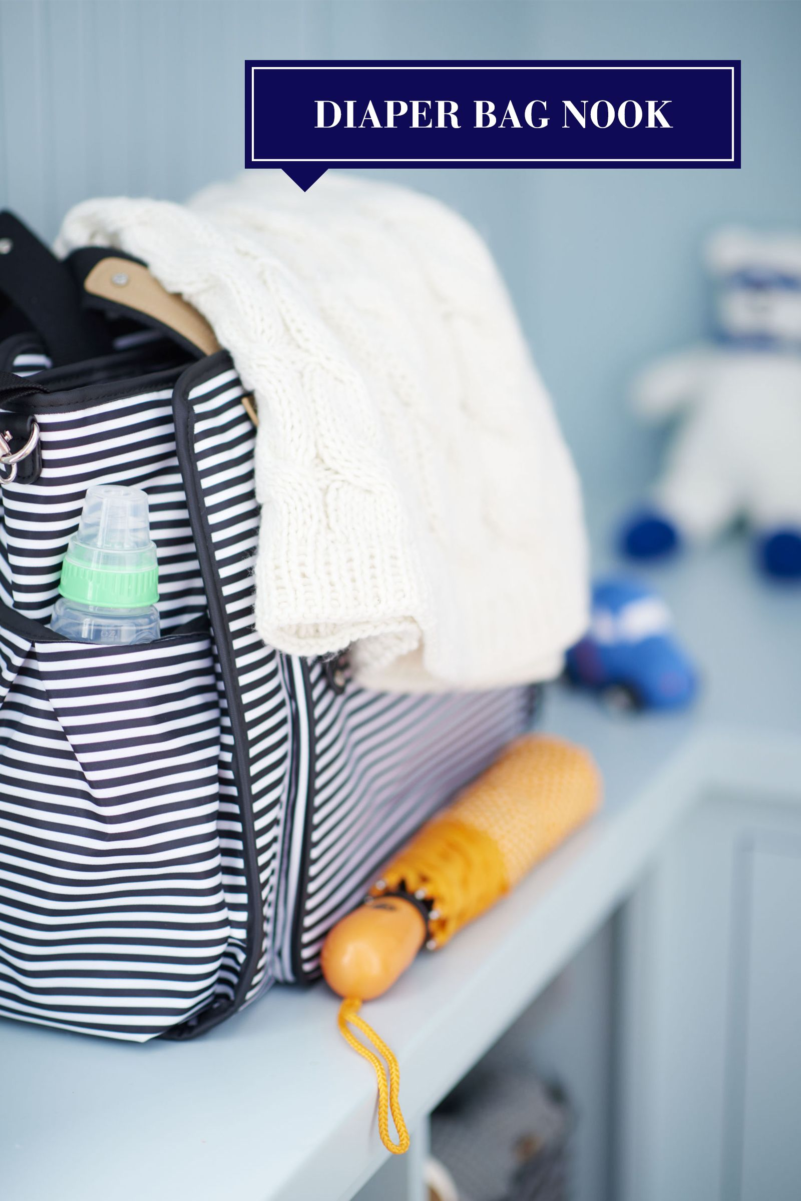 """<p>While your nursery may be the go-to for baby gear, the secret to getting out the door with a little one in tow is to keep an extra set of essentials by the entryway. Dedicate a shelf in your mudroom to diaper bag necessities (diapers, wipes, changing pads, etc.) to ensure a hasty and unharried exit.</p><p><em>Diaper bag, <a href=""""http://www.skiphop.com/product/diaperbags/grandcentraldiaperbag.html"""" target=""""_blank"""">skiphop.com</a>; car rattle and knit bear, <a href=""""http://www.estella-nyc.com/"""" target=""""_blank"""">estrella-nyc.com</a></em><br></p>"""