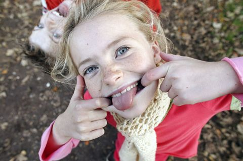 girl sticking out her tongue