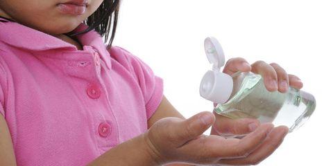 Kid Using Sanitizer