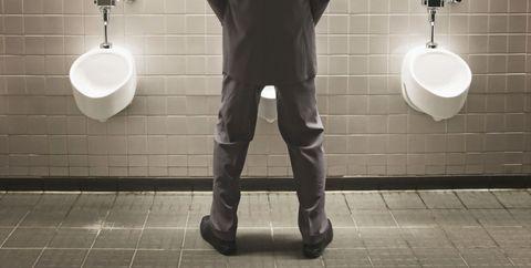 Man at Public Bathroom Urinal