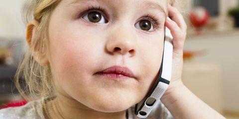 Little Girl Using Phone