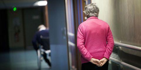 Woman Walking Through Nursing Home