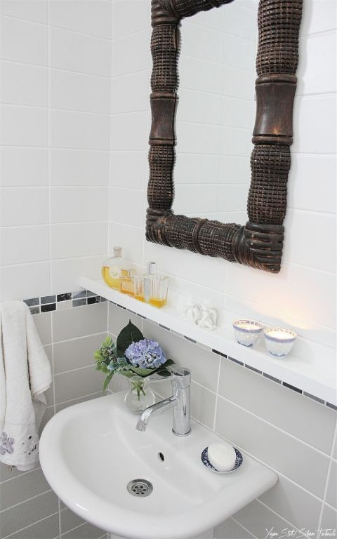 "<p>Nothing's more frustrating than a sink without any storage. But this narrow shelf fits above your faucet and below your mirror so you can <a href=""http://www.housebeautiful.com/lifestyle/organizing-tips/g2784/ikea-bathroom-hacks/"" target=""_blank"">add organization</a> for soap, candles, and toothpaste where you need it most.</p><p><a href=""http://www.yasamstil.com/2013/06/banyo-ilham/"" target=""_blank""><em>See more at Yasam Stil »</em></a></p>"
