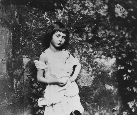 Alice Liddell original Alice in Wonderland 1858: Alice Liddell (1852 - 1934), the inspiration for Lewis Carroll's fictional character Alice in 'Alice in Wonderland'. She is posing as 'The Beggar-Maid.'