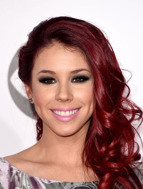 Getty Images Vibrant Cranberry To Keep Your Gorgeous Hair Color Looking Bright