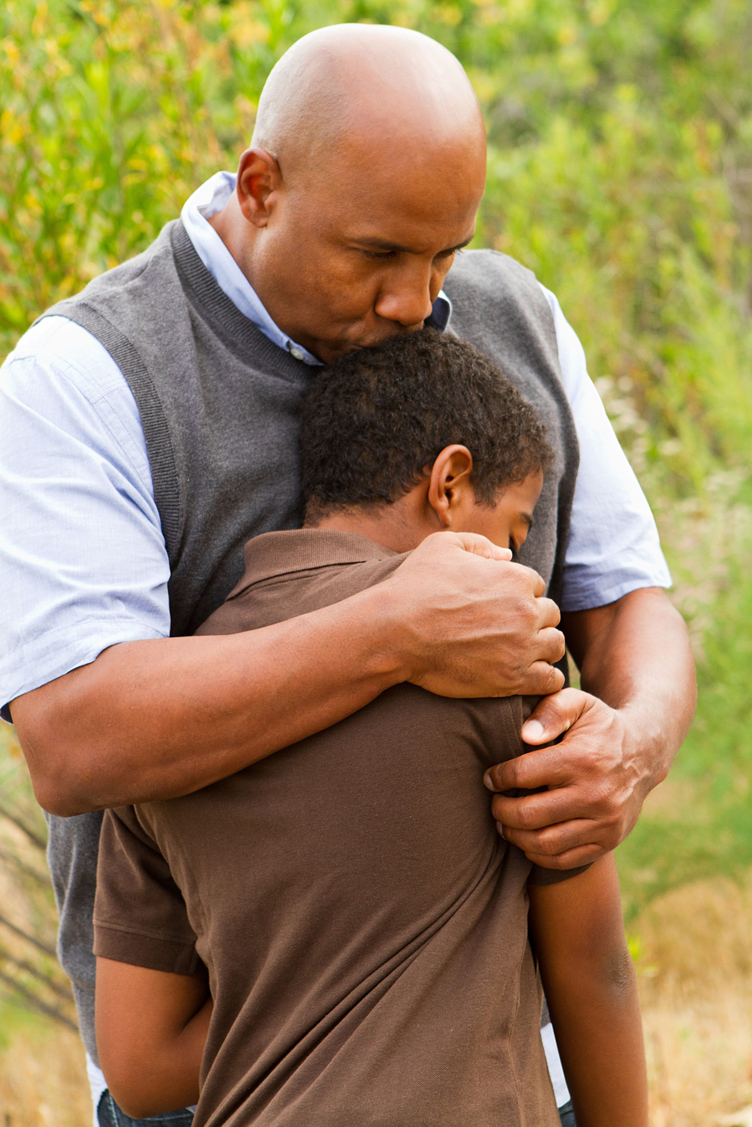 father comforting his son dad tragedy