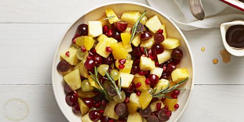 """<p>Fruit salad doesn't have to be boring. We added pomegranate seeds and a rosemary infused syrup to make this one more festive. </p><p><a href=""""http://www.goodhousekeeping.com/food-recipes/easy/a35801/pineapple-pom-fruit-melange/"""" target=""""_blank"""">Get the recipe for Pineapple-Pom Fruit Melange »</a><br></p>"""