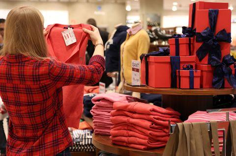 Woman holiday shopping at store