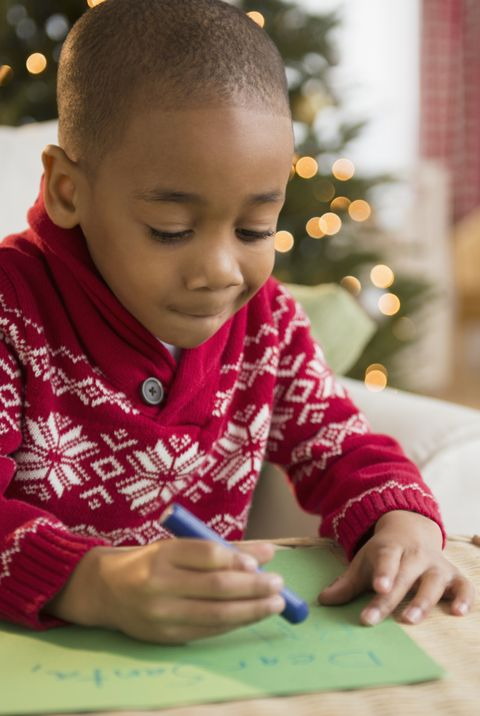 Christmas facts-boy writing letter to santa claus