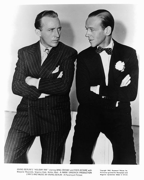 bing crosby and fred astaire with their arms folded staring at one an other in a - Where Was White Christmas Filmed