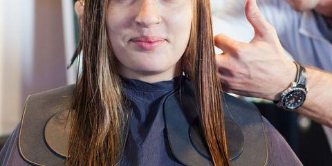 Woman Getting a Haircut at Hair Salon