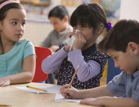 girl student sneeze allergies classroom