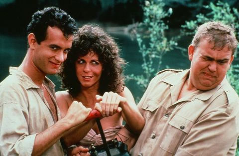 CIRCA 1984: Tom Hanks, Rita Wilson and John Candy pose for the TriStar Pictures movie 'Volunteers' circa 1984.