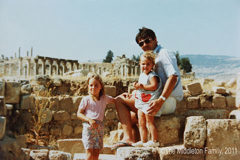 In this Handout Image provided by Clarence House www.officialroyalwedding2011.org, Kate Middleton with sister Pippa and Father Michael in Jerash, Jordan. The Middleton Family moved to Amman, Jordan for two and a half years.