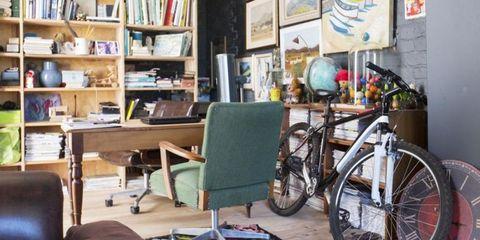 Bicycle tire, Bicycle wheel rim, Bicycle wheel, Bicycle accessory, Bicycle frame, Room, Bicycle part, Bicycle, Bicycle saddle, Furniture,