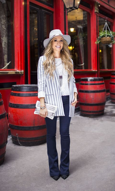 """<p>This jacket is a cut below the rest. The best part: the flattering length hides your tush! Wear it with a streamlined look (think dark slim-cut jeans with a slight flare — they're back!) and a tucked tee now, then swap for a summer-ready all-white outfit later.</p><p><em><strong>Blazer</strong>, $185, <a href=""""http://scotch-soda.com"""" target=""""_blank"""">scotch-soda.com</a>. <strong>Blouse</strong>, French Connection, $138, <a href=""""http://bloomingdales.com"""" target=""""_blank"""">bloomingdales.com</a>. <strong>Jeans</strong>, $149, <a href=""""http://shophenryandbelle.com"""" target=""""_blank"""">shophenryandbelle.com</a> (20% off sitewide with exception of sale items for GH readers with code GH20). <strong>Hat</strong>, $220, <a href=""""http://sarahjcurtis.com"""" target=""""_blank"""">sarahjcurtis.com</a>. <strong>Earrings</strong>, $4, <a href=""""http://forever21.com"""" target=""""_blank"""">forever21.com</a>. <strong>Necklace</strong>, $55, <a href=""""http://whbm.com"""" target=""""_blank"""">whbm.com</a>. <strong>Clutch</strong>, $10, <a href=""""http://boohoo.com"""" target=""""_blank"""">boohoo.com</a>. <strong>Turquoise bangle</strong>, $48, <a href=""""http://jewelrystorm.com"""" target=""""_blank"""">jewelrystorm.com</a>. <strong>Python bangles</strong>, $30 each, <a href=""""http://avmaxnyc.com"""" target=""""_blank"""">avmaxnyc.com</a>. <strong>Heels</strong>, $35, Marshalls.</em></p><p><em><strong>On location:</strong> </em><a href=""""http://shipandshovell.co.uk/"""" target=""""_blank""""><em>The Ship & Shovell</em></a></p>"""