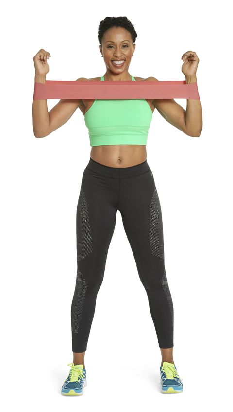 <p><strong><em>Works chest, back, and arms</em></strong></p><p>Standing with feet hip-distance apart, loop band around wrists, then raise elbows to just below shoulder height and bend arms 90 degrees. Spread arms into goalpost position (as shown). Hold for one count, then bring arms back to shoulder-width apart for one rep. Repeat 12 times. And pay attention to your posture: Drop shoulders down and squeeze shoulder blades together.</p>