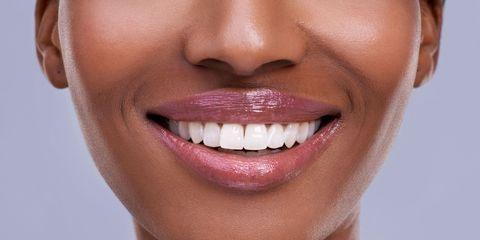 Lip, Cheek, Brown, Skin, Chin, Forehead, Tooth, Eyebrow, Eyelash, Facial expression,