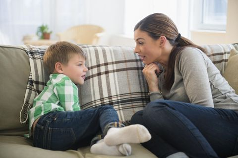 mother son boy having conversation couch single parent
