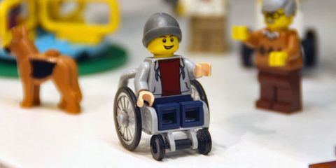 Toy, Personal protective equipment, Helmet, Baby toys, Lego, Fictional character, Plastic, Auto part, Tread, Synthetic rubber,