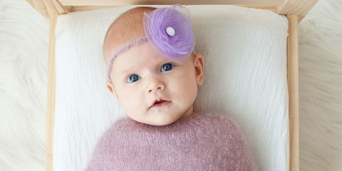 Baby with purple flower headband