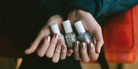 Finger, Skin, Hand, Nail, Wrist, Thumb, Nail care, Silver, Ring, Gesture,