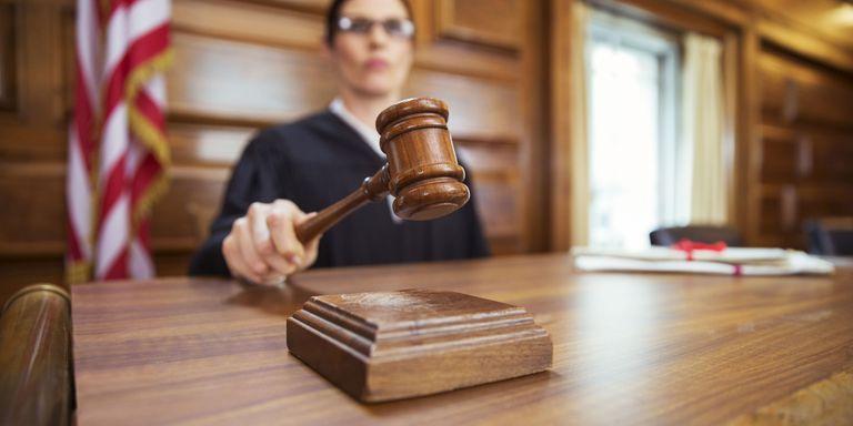 Resultado de imagem para courtroom while waiting for his case to come before the judge