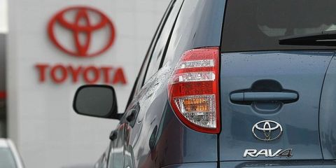 Motor vehicle, Automotive tail & brake light, Automotive design, Automotive lighting, Automotive exterior, Car, Automotive mirror, Glass, Hatchback, Logo,