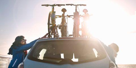 Automotive exterior, Car, Automotive tail & brake light, Hatchback, Automotive carrying rack, Trunk, Sport utility vehicle, Family car, Roof rack, Automotive window part,