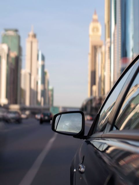 Automotive mirror, Motor vehicle, Mode of transport, Automotive design, Daytime, Glass, Automotive side-view mirror, Road, Rear-view mirror, Reflection,