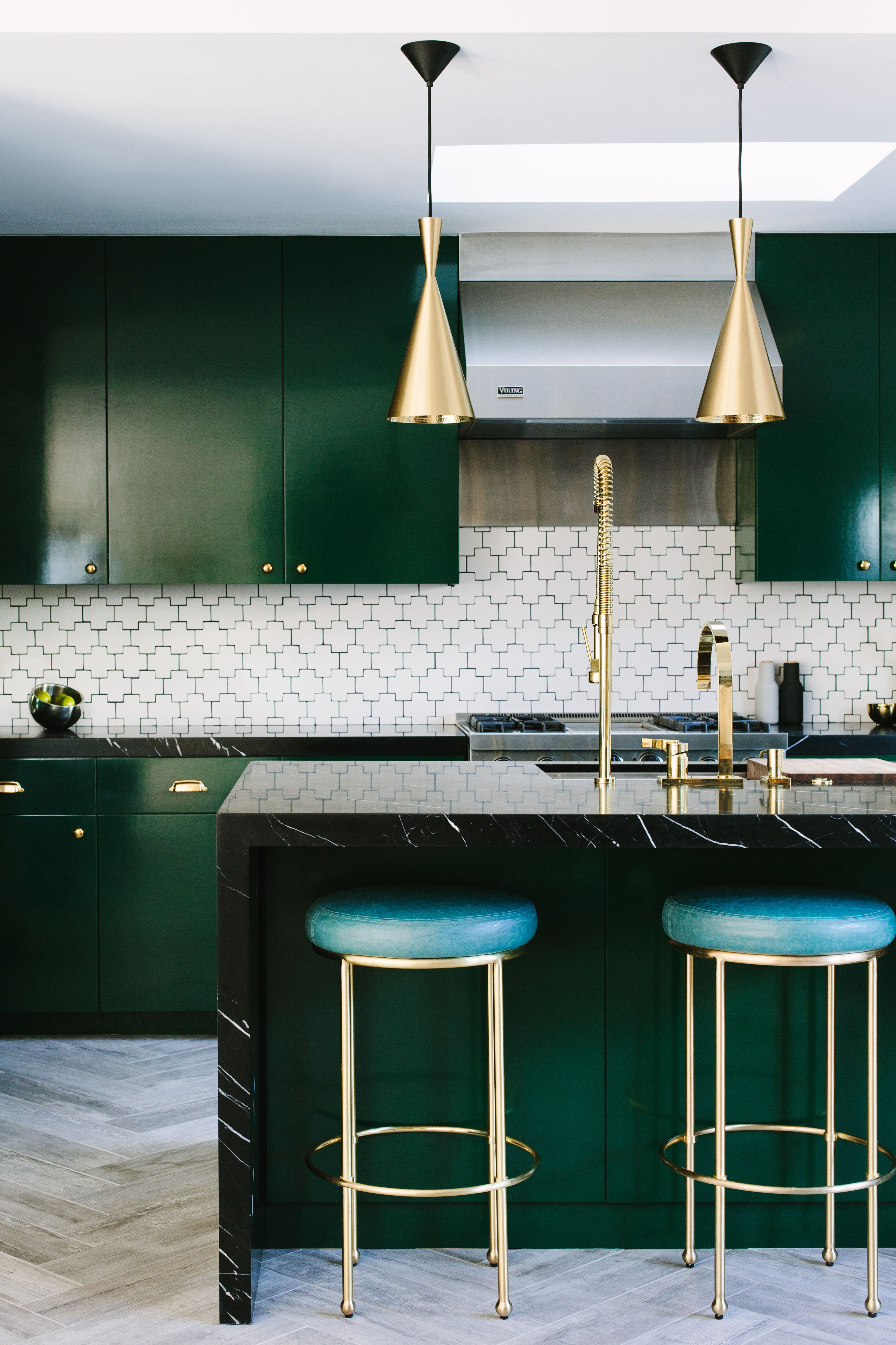 """<p>Tile offers a repeating pattern to your backsplash, floor, or counter no matter its shape — and that can make you think the quietest options (like rectangles and squares) are the safest. But in a solid or neutral hue, more playful patterns dial up your kitchen's decor without overwhelming the space. </p><p><br> </p><p>""""I stumbled across this backsplash (Swiss Cross by Ann Sacks) while searching for something that <em>looked</em> like subway tile, but wasn't,"""" says Caitlin Murray of <a href=""""http://www.blacklacquerdesign.com/"""" target=""""_blank"""">Black Lacquer Design</a>. """"I was reluctant to introduce a new color pattern into this kitchen because the cabinets and counters are so strong, but I wanted a backsplash that held its own. The geometric lines complement the modern style of the kitchen — it's a traditional element with a contemporary twist.""""<br></p>"""