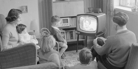 Hair, Head, Human, Lighting, Room, Mammal, Child, Interior design, Television set, Display device,