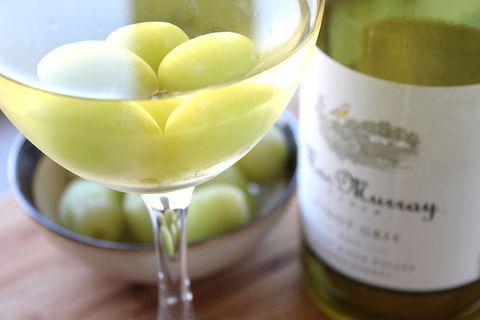 Yellow, Bottle, Glass bottle, Fluid, Wine bottle, Drink, Drinkware, Liquid, Alcohol, Tableware,