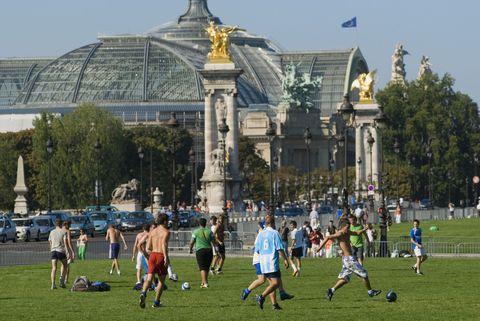 boys playing soccer in paris