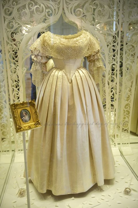 A dress worn by Britain's Queen Victoria on her wedding day to Prince Albert in 1840 is pictured in Kensington Palace in central London, on March 20, 2012, during a photocall to showcase a GBP12m (14.4m euros/19m USD) restoration of the historic palace. The restoration also features an exhibition of dresses worn by Diana, Princess of Wales. AFP PHOTO/MIGUEL MEDINA (Photo credit should read MIGUEL MEDINA/AFP/Getty Images)
