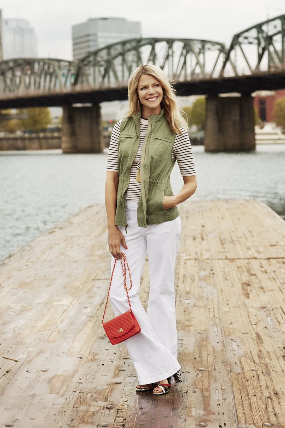 """<p>Look slimmer and taller in this ultra-flattering cut. One rule: Always pair them with heels. </p><p><em><strong>Vest</strong>, Merona, $30, <a href=""""http://target.com"""" target=""""_blank"""">target.com</a>. <strong>Sweater</strong>, $35, <a href=""""http://hm.com"""" target=""""_blank"""">hm.com</a>. <strong>Jeans</strong>, $70, <a href=""""http://gap.com"""" target=""""_blank"""">gap.com</a>. <strong>Hoops</strong>, $24, <a href=""""http://marlynschiff.com"""" target=""""_blank"""">marlynschiff.com</a>. <strong>Necklace</strong>, $40, <a href=""""http://thelimited.com"""" target=""""_blank"""">thelimited.com</a>. <strong>Gold ring</strong>, $90, and <strong>silver ring</strong>, $65, <a href=""""http://pandora.net"""" target=""""_blank"""">pandora.net</a>. <strong>Bag</strong>, $55, <a href=""""http://urbanexpressions.net"""" target=""""_blank"""">urbanexpressions.net</a> (25% off sitewide for </em>GH<em> readers with code UE-GOODHSKPG25). <strong>Shoes</strong>, $30, Primark stores.</em> </p><p><em><strong>On location:</strong> <a href=""""https://www.portlandoregon.gov/parks/finder/index.cfm?&propertyid=105&action=viewpark"""" target=""""_blank"""">Eastbank Esplanade</a></em> </p><p><em>Take a scenic stroll on the Williamette River.</em></p>"""