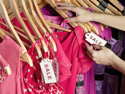 pink shirts for sale in a retail store